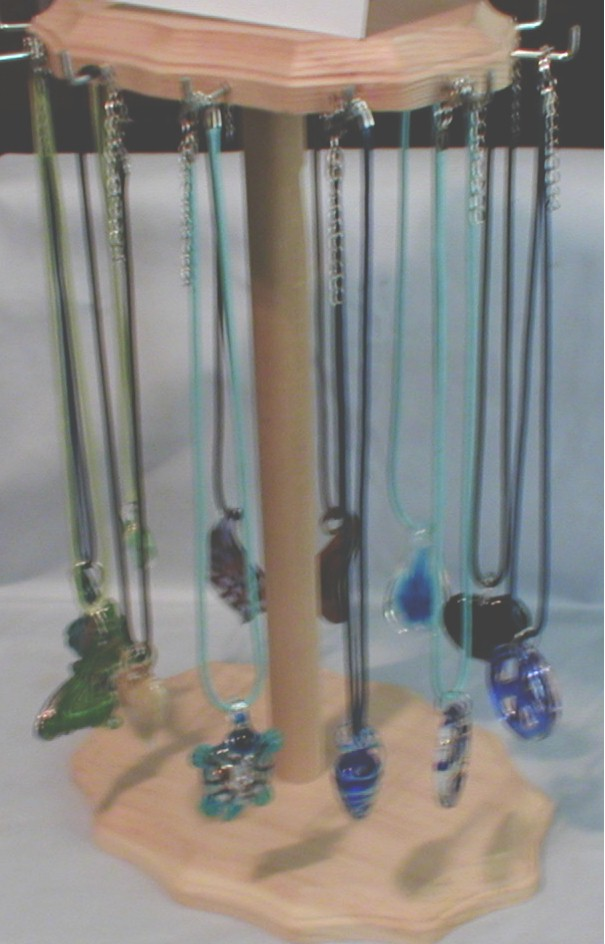 Display With Arte Glass Pendant Necklaces